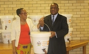 Dr. Kalumbi Shangula, Health Minister, receiving the donation of hygiene kits from UNFPA Representative.